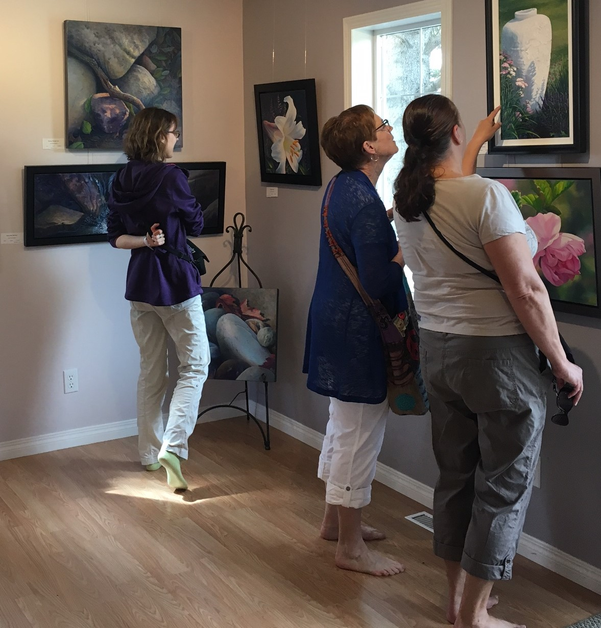 Guests looking at art in the studio Saturday morning.