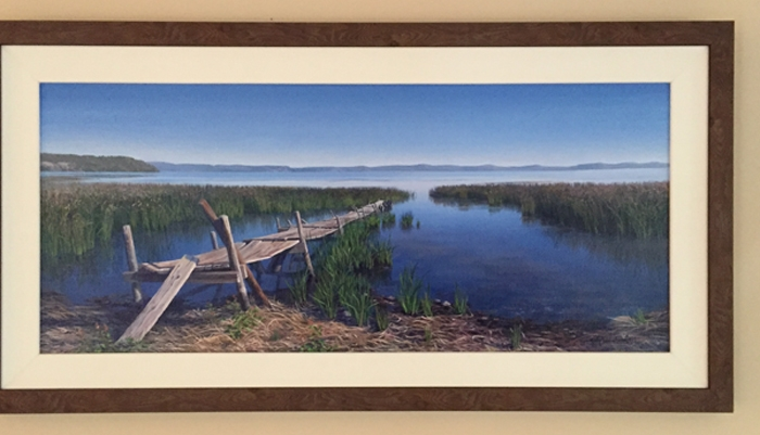 """Above: """"Echoes Through Time"""", 14"""" x 32"""", shown framed and haging in the client's home."""