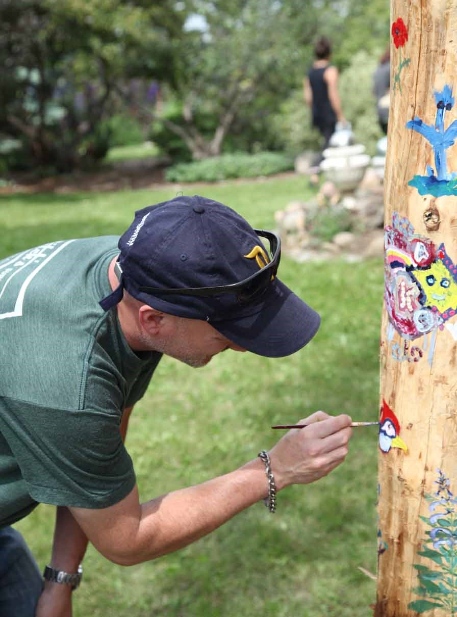 Here we have my friend painting on the trunk of a retired spruce tree. This was a new activity for this year which turned out to be pretty neat!