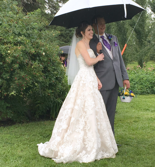 We were all amazed by how the rain stayed away during the ceremony. Here are the brand new Mr. & Mrs. shortly after the ceremony.