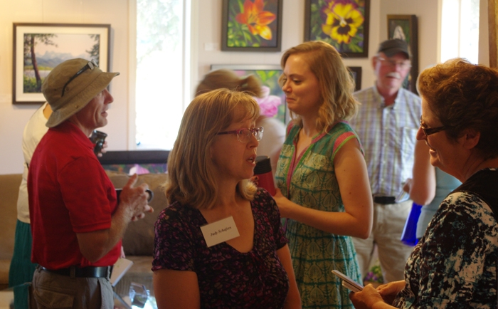 Judy speaking to a client at an open studio event.
