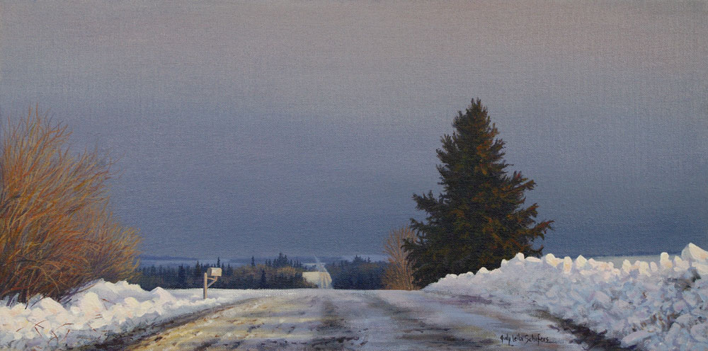 road of life, rural gravel road in winter with stormy sky and spruce tree