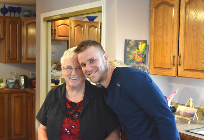 grandmother and grandson smiling