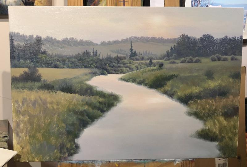 painting a river scene in progress